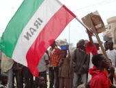 A protester holds an Iranian flag during a protest march against the USproduced antiIslam movie in the northern Nigerian city of Kano on September 22...