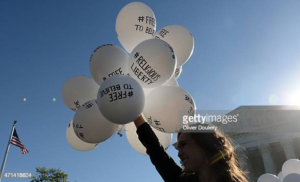 A protester holds balloons calling for religious freedom outside the US Supreme Court on April 28 2015 in Washington DC The Supreme Court meets to...