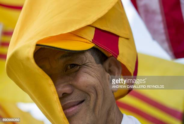 A protester holds the Vietnamese red flag with gold star designed in 1940 and used during an uprising against French rule in southern Vietnam during...