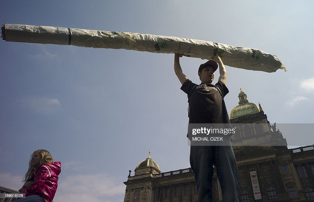 A protester holds up a imitation of a big joint as he takes part in a demonstration for the legalization of marijuana, in Prague on May 4, 2013.