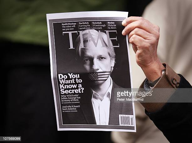 A protester holds up a photo copy of the front cover of Time Magazine featuring Wikileaks founder Julian Assange outside Westminster Magistrates...