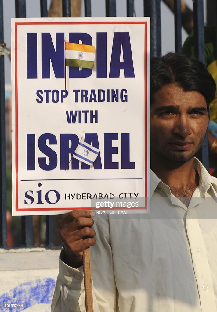 A protester holds up a placard as he and members of Jamaat-e-Islami Hind and Students of Islamic Organisation (SIO) demonstrate against Israel on June 2, 2010, to denounce the Israel assault on an aid flotilla bound for Gaza. The hundreds of activists detained in a deadly raid on a Gaza-bound flotilla have all been released from prison to be deported, a prisons authority spokesman said June 2. AFP PHOTO / Noah SEELAM