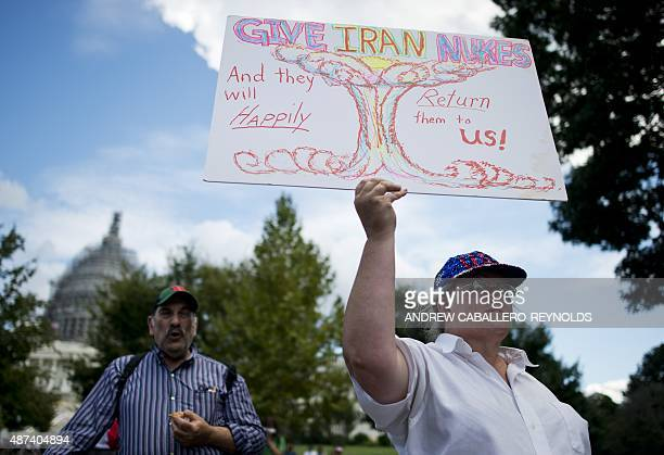 A protester holds up a placard during a Tea Party rally against the international nuclear agreement with Iran outside the US Capitol in Washington DC...