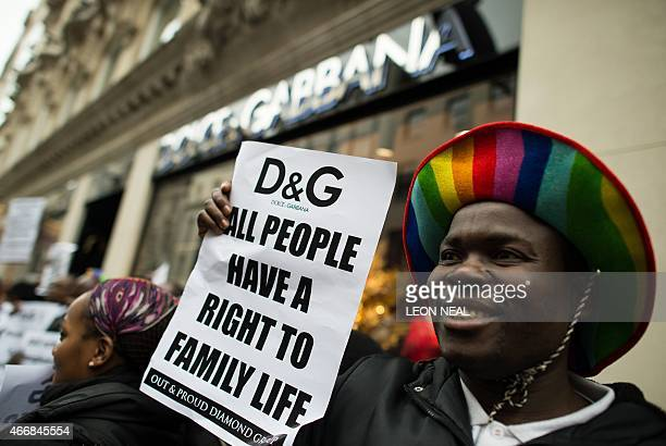 A protester holds up a placard reading 'All people have a right to family life' outside a branch of Italian fashion label Dolce and Gabbana in...