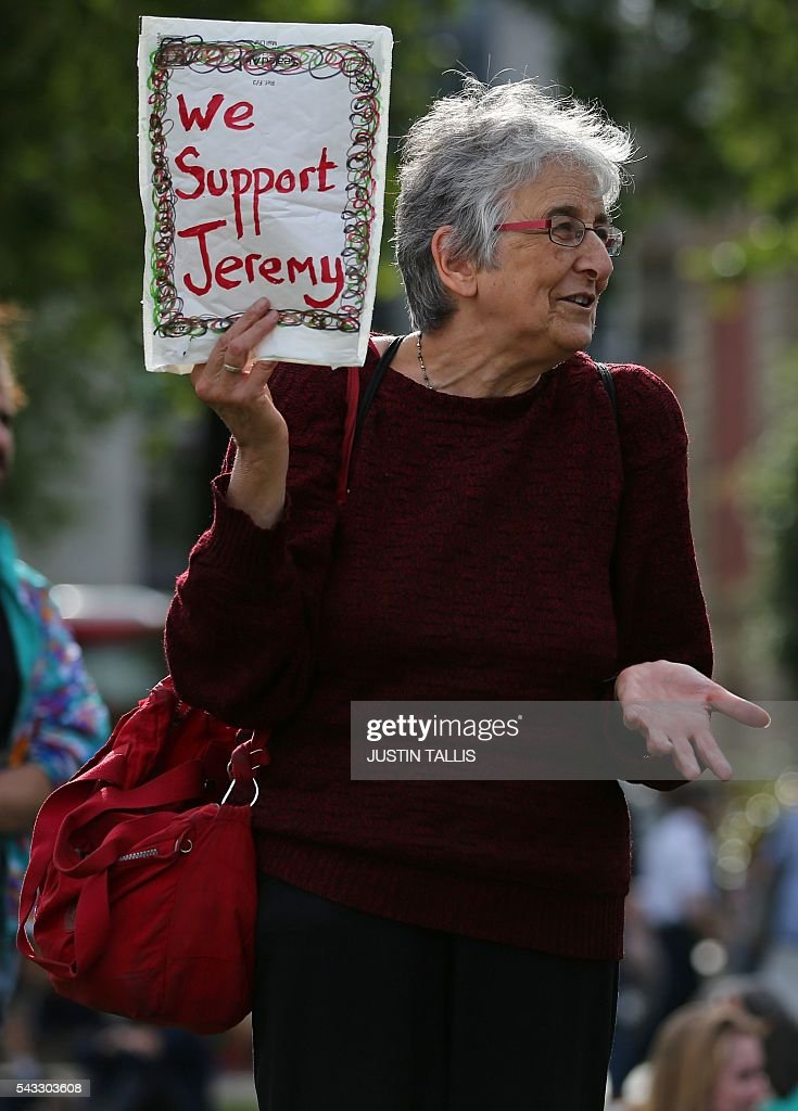 A Protester holds up a poster in support of Leader of the opposition Labour Party Jeremy Corbyn outside parliament during a pro-Corbyn demonstration in central London on June 27, 2016. Britain's historic decision to leave the 28-nation bloc has sent shockwaves through the political and economic fabric of the nation. It has also fuelled fears of a break-up of the United Kingdom with Scotland eyeing a new independence poll, and created turmoil in the opposition Labour party where leader Jeremy Corbyn is battling an all-out revolt. TALLIS