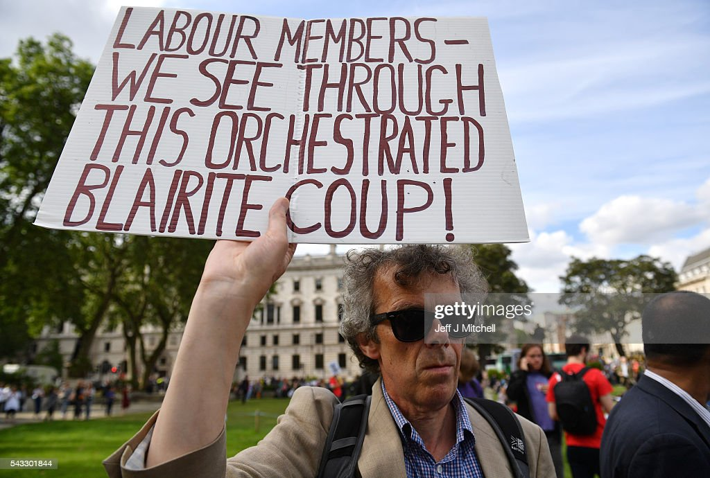 A protester holds up a sign accusing Labour members of a 'Blairite Coup' during Momentum's 'Keep Corbyn' rally outside the Houses of Parliament on June 27, 2016 in London, England. The Labour Leader has seen mass resignations from the Shadow Cabinet in the wake of the UK Vote for Brexit. His support group, Momentum, have recorded more than 1000 new members in the same period.