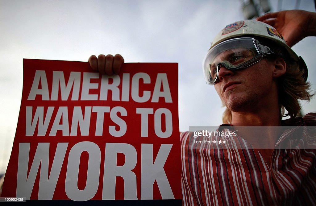 A protester holds up a sign during a march that was put on by West Central Florida Federation of Labor to, in their words, 'demonstrate the reality of Mitt Romney's America' as the Republican National Convention continues at the Tampa Bay Times Forum on August 29, 2012 in Tampa, Florida. The Republican Party delegates affirmed Mitt Romney as the party's nominee for President of the United States.