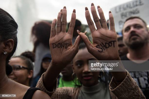 TOPSHOT A protester holds up her hands with a slogan written on them during a demonstration against police brutality in Charlotte North Carolina on...