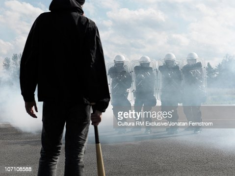 Protester in front of policemen