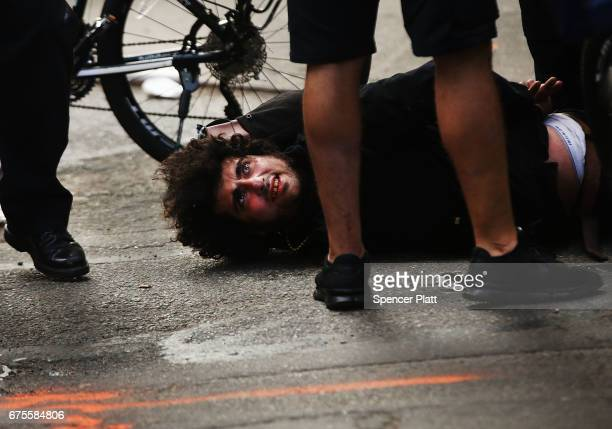 A protester is arrested as he marches with others from New York's Union Square on May Day on May 1 2017 in New York New York Across the country and...