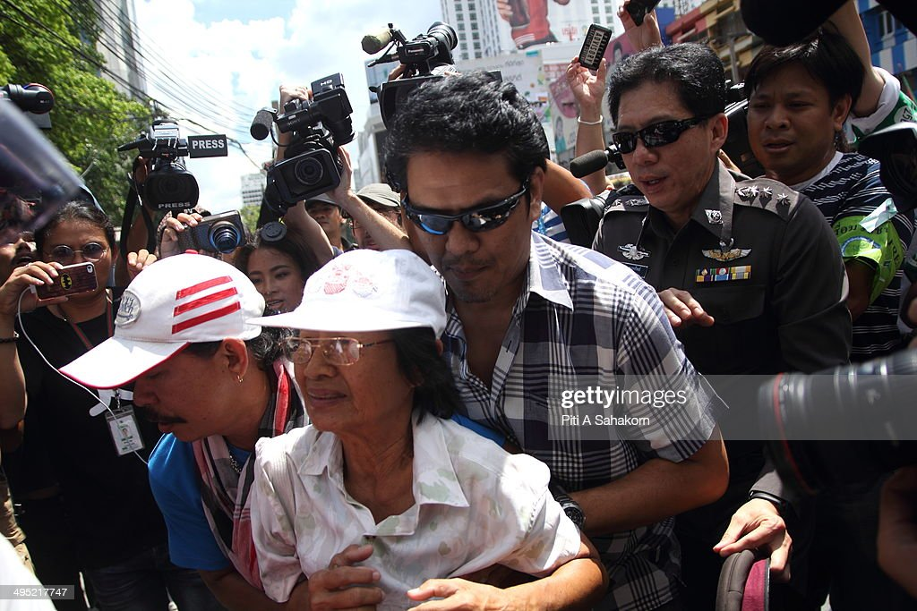 A protester is arrested by plainclothes Thai police officers after staging an anti-coup demonstration in Bangkok. Hundreds of demonstrators gathered Sunday near a major shopping mall in downtown Bangkok to denounce the country's May 22 coup despite a lockdown by soldiers of some of the city's major intersections. Troops and riot police were stationed in the central shopping district where one political activist had vowed to host a coup party.