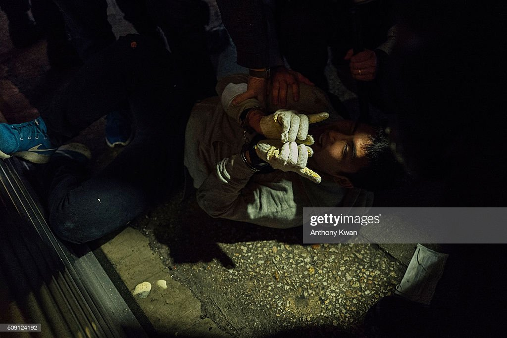 A protester is arrested by the police at Mongkok on February 9, 2016 in Hong Kong. More than 40 police officers and journalists have been injured after a riot with protesters on the first day of Chinese New Year celebrations.