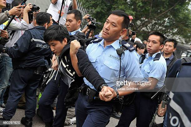 A protester is being arrested and carried away by police officers during the clearance of Occupy Central Prodemocracy camp in Admirality on December...