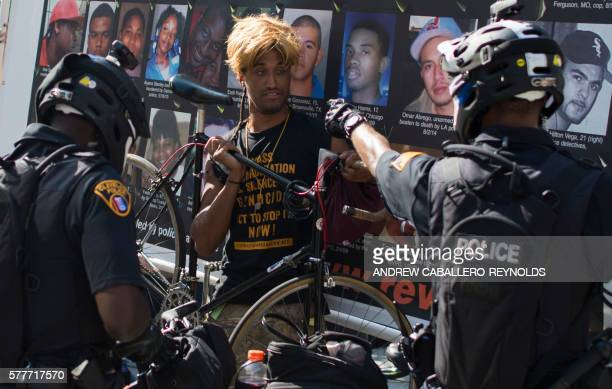 TOPSHOT A protester is confronted by police during a rally outside the Republican National Convention in Cleveland Ohio on July 19 2016 The...