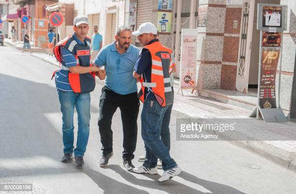 A protester is detained by Morocco security forces during a demonstration continue over 7 months in Al Hoceima Morocco on July 20 2017 People demand...
