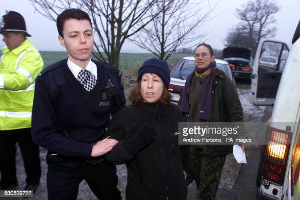 A protester is detained by police outside Huntingdon Life Sciences Cambridgeshire during a demonstration The drugtesting firmfaced an anxious wait to...
