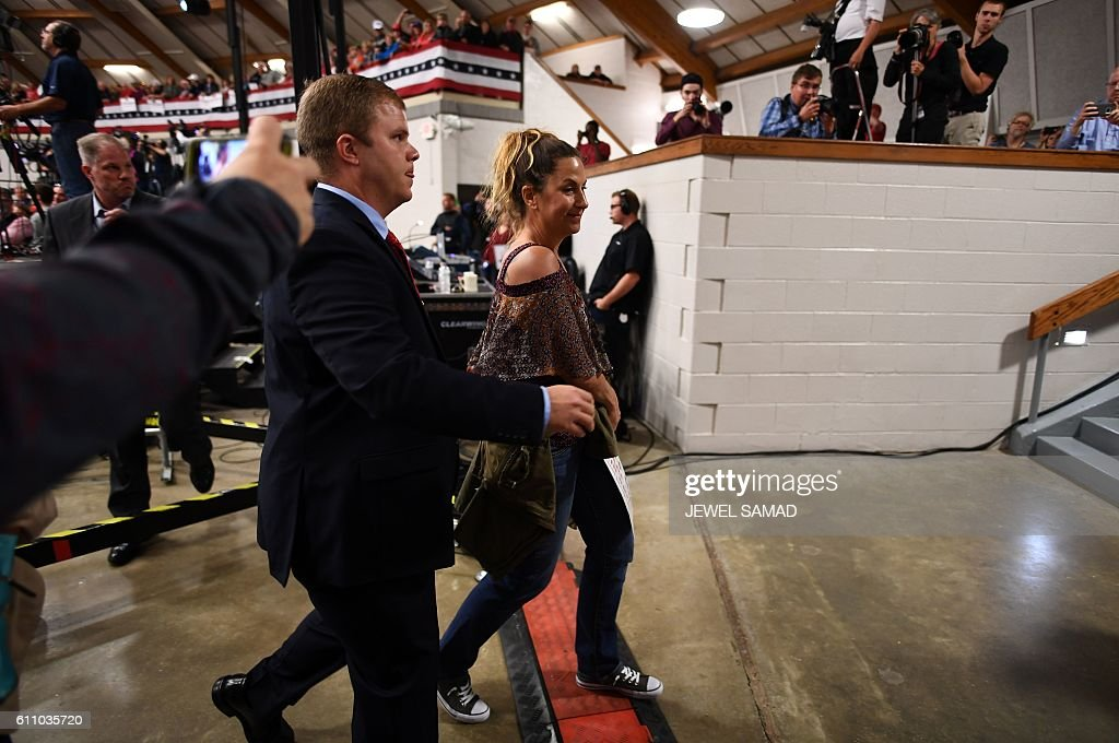 A protester is escorted out of the venue as US Republican presidential nominee Donald Trump speaks during a campaign rally at the County Expo Center in Waukesha, Wisconsin, on September 28, 2016. / AFP / JEWEL