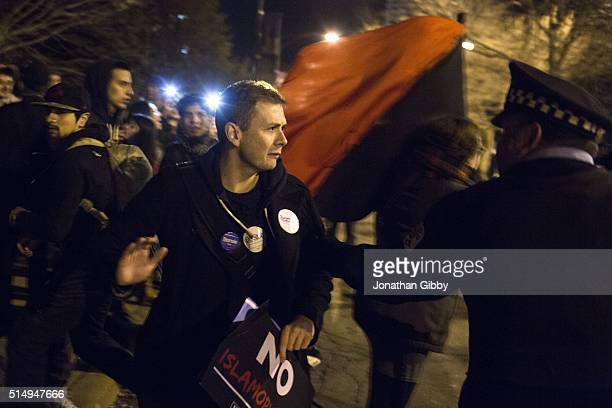 A protester is grabbed by a Chicago Police Officer outside of the University of Illinois at Chicago Pavilion where Republican presidential candidate...