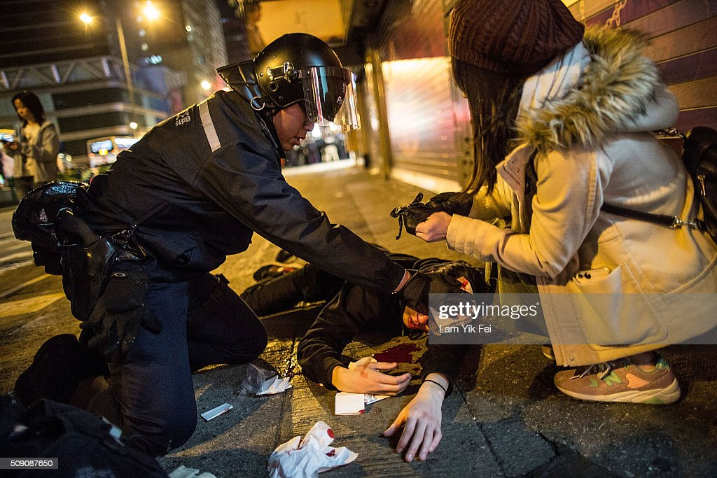 A protester is injured in Mong Kok district of Hong Kong on February 9, 2016 in Hong Kong. More than 40 police officers and journalists have been injured after a riot with protesters on the first day of Chinese New Year celebrations.