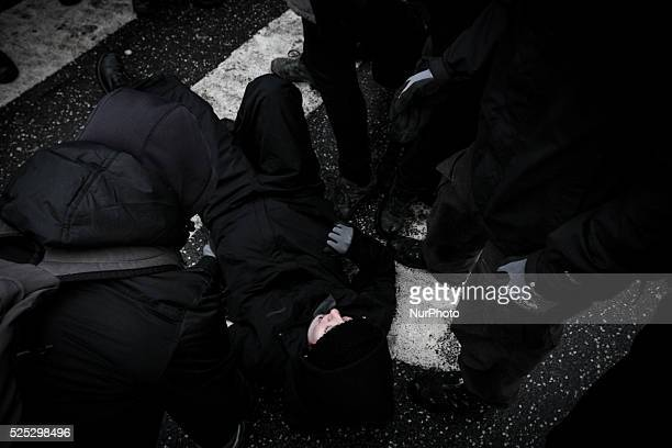 A protester is knocked unconscious by police officers is aided by fellow activists Clashes between antiislamist protesters and antifascist activists...