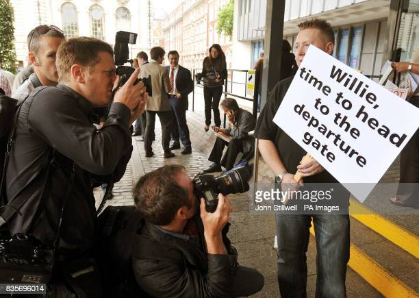 A protester is photographed outside the BA Annual General Meeting at the Queen Elizabeth centre London