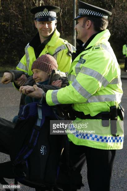 A protester is removed by police outside Faslane on the River Clyde Scotland the Trident nuclear submarine base