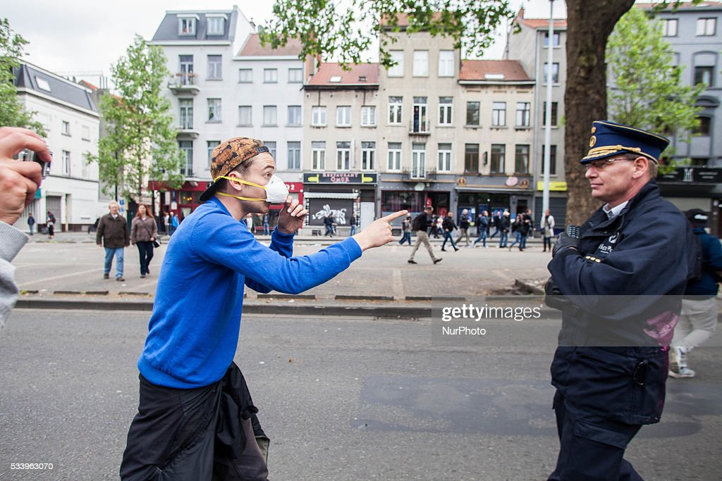 A protester is seen argueing with chief police officer Vandersmissen, who later got wounded during an anti government protest in Brussels on May 24, 2016.