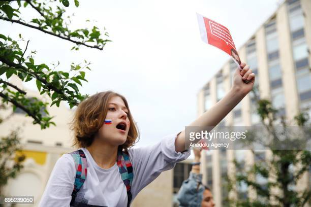 A protester is seen during an unauthorized rally after Russian liberal opposition leader Alexei Navalny called to hold a protest in Tverskaya street...