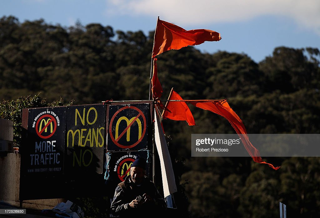 A protester is seen on July 3, 2013 in Melbourne, Australia. Janine Watson is spending her third consecutive day on the rooftop of a building currently under proposal to be demolished, making way for a new 24 hour McDonald's restaurant, today also marks her 50th Birthday.