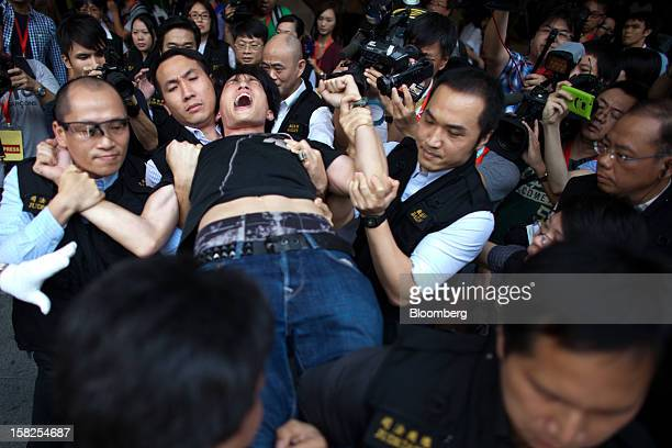 'BEST PHOTOS OF 2012' A protester is taken away by court bailiffs at the Occupy Central camp in the plaza beneath HSBC Holdings Plc's Asian...