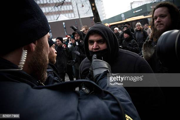 A protester is threatened with immediate arrest if he cross a police line formed between the PEGIDA rally and the counter protest Clashes between...