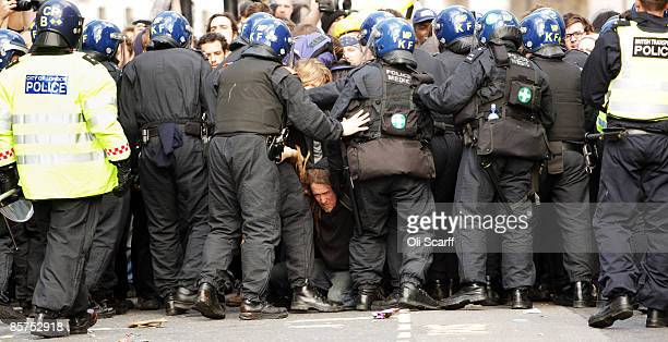A protester is trapped in the police line as anticapitalist and climate change activists demonstrate in the City of London on April 1 2009 in London...