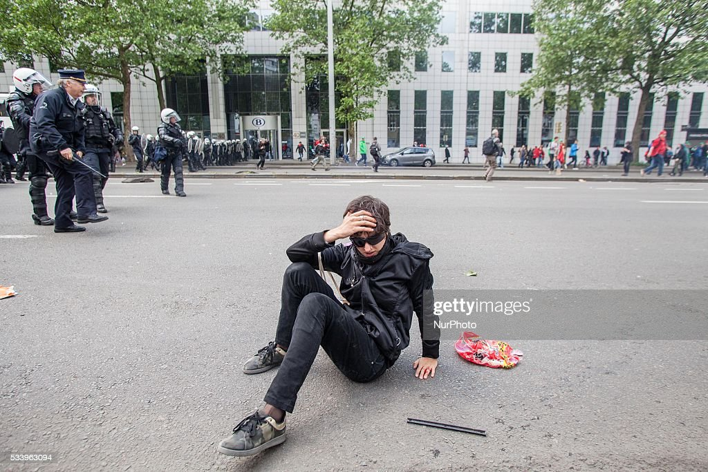 A protester lies on the ground after a police charge. An anti-government protest ended up in a riot in Brussels on May 24, 2016.