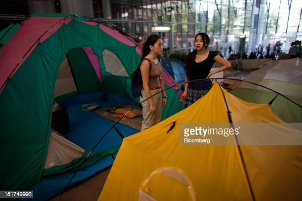 Protester look on at the Occupy Central camp in the plaza beneath HSBC Holdings Plc's Asian headquarters in Hong Kong China on Tuesday Sept 11 2012...