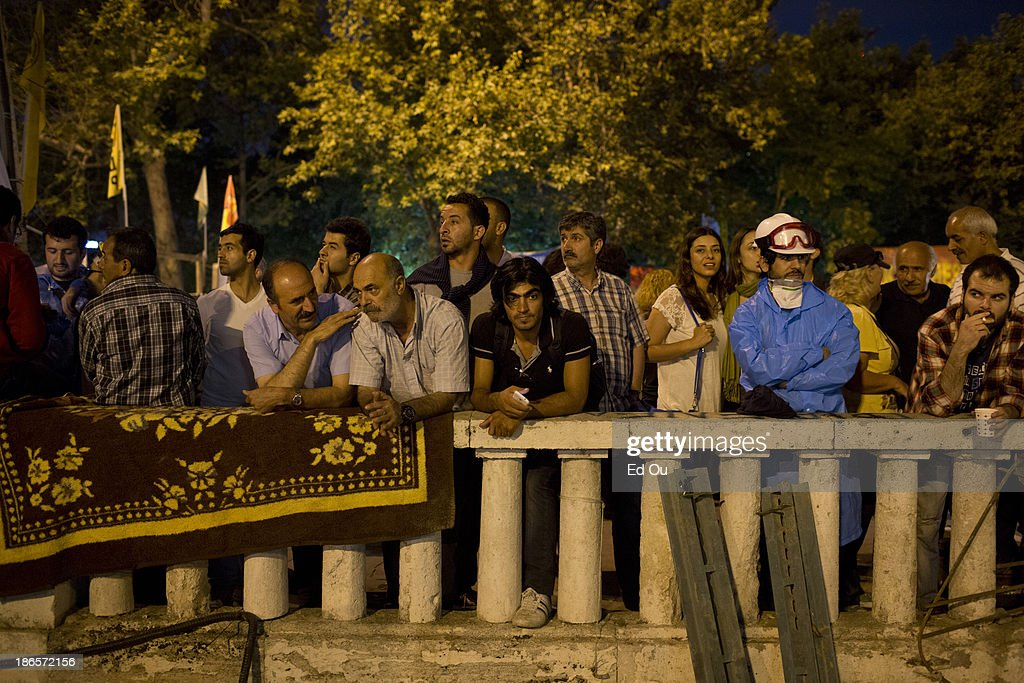Protester look out into Taksim Square in Istanbul Turkey on June 13 2013 Prime Minister Recep Tayyip Erdogan offered on Wednesday to hold a...