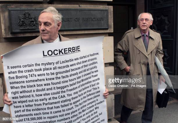 A protester looks on as Reverend John Mosey whose 19yearold daughter Helga died in the bombing over Lockerbie departs a hearing to discuss a bid by...