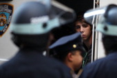A protester looks out from a police van after being arrested during 'Occupy Wall Street' protests on September 17 2012 in New York City The 'Occupy...
