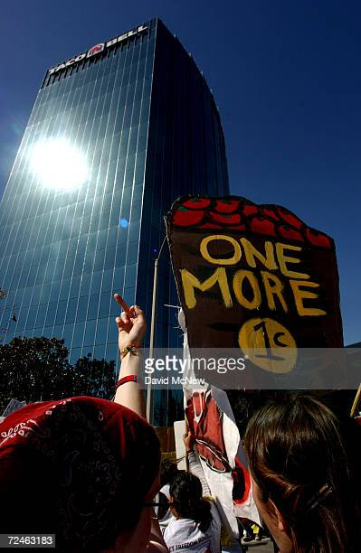 A protester makes obscene gestures at the corporate offices of Taco Bell seen in the background March 11 2002 in Irvine CA The demonstrators opposed...