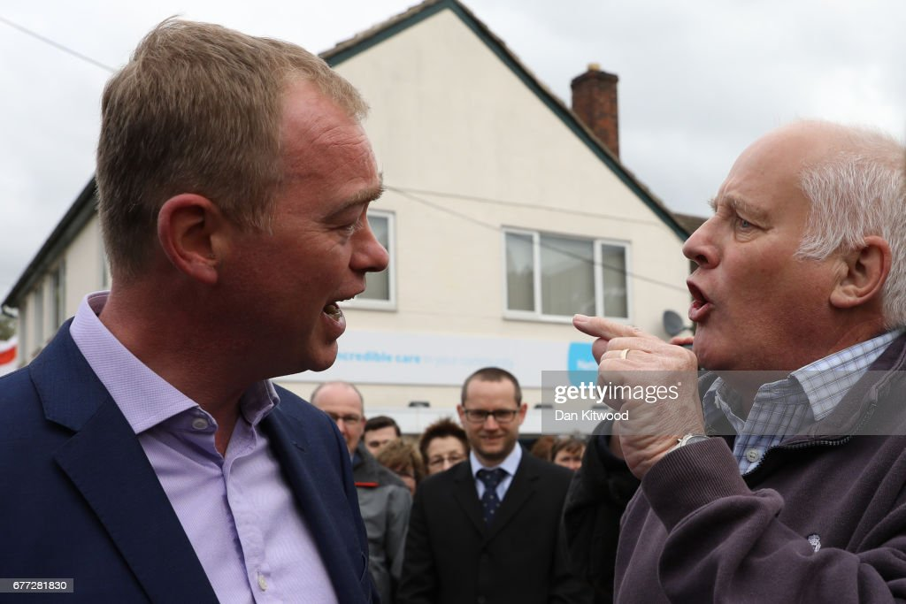 Protester Malcolm Baker (R), a life long member of the Labour party voting Tory, discusses Brexit, agreeing to disagree with Liberal Democrat leader Tim Farron at a campaign event on May 3, 2017 in Kidlington, a village outside of Oxford, England. The country goes back to the polls for the second time in two years as a general election is held on June 8.