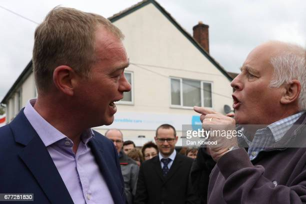 Protester Malcolm Baker a life long member of the Labour party voting Tory discusses Brexit agreeing to disagree with Liberal Democrat leader Tim...