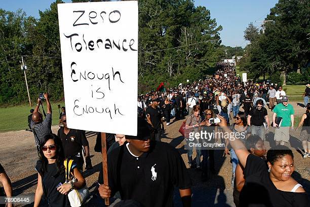 A protester marches with a sign near Jena High School during a civil rights march September 20 2007 in Jena Louisiana Thousands of protesters have...