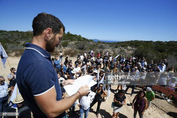 Protester Maxime Susini gives a speech in front of houses built by Pierre Ferracci president of Alpha group on the conservation area of Rondinara...