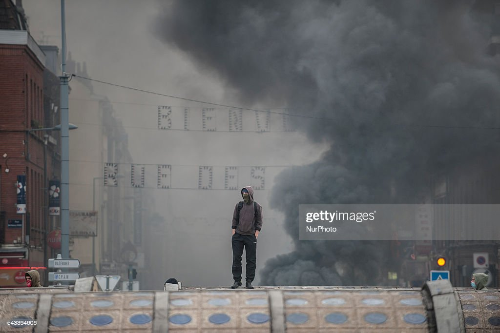 A protester observes the barricades roundabout Posts blocked by trade unionists of the CGT in Lille, France on june 28, 2016. A new national day of action against labor law takes place throughout the la France. Economic blocking action was planned by the CGT in Lille this morning at 6:30 am.