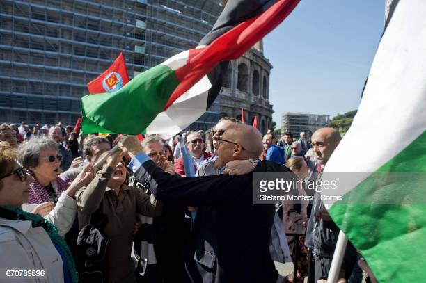 A protester of the Jewish community tries to snatch a Palestinian flag to the protesters proPalestinian during the march for the Liberation of...