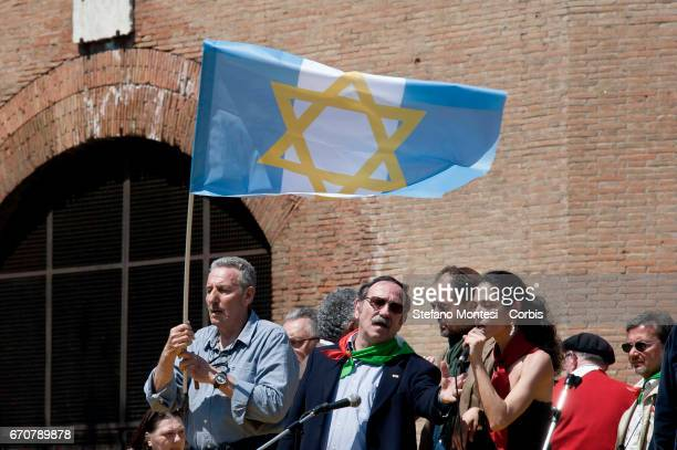 A protester of the Jewish community with the flag of Israel on the stage of the institutions during the march for the Liberation of Nazifascism...