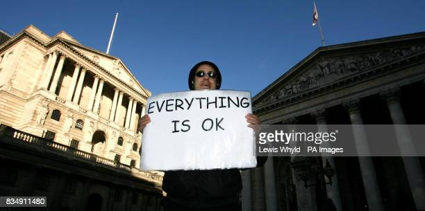 A protester outside the Bank of England in London as interest rates are cut