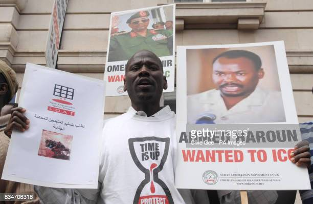 A protester outside the Sudanese embassy in central London demonstrating for justice in Darfur in support of International Criminal Court whose...
