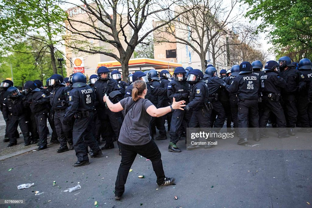 A protester poses in front of German riot policemen during clashes after a march on May Day on May, 2016 in Berlin, Germany. Tens of thousands of people across Germany participated in marches and gatherings by labor unions and in some cities left-wing and anarchist activists took to the streets under heavy oversight by police. In Berlin far-right protesters also attempted to hold rallies during the day.