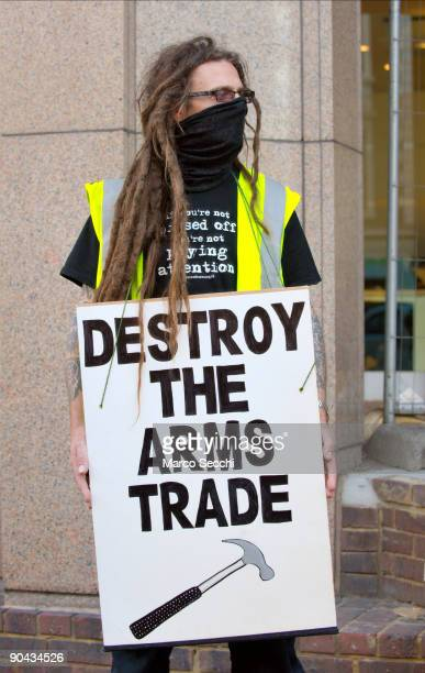A protester poses in front of the Axa building in the City of London as they target the buildings of major corporations and banks that invest in the...