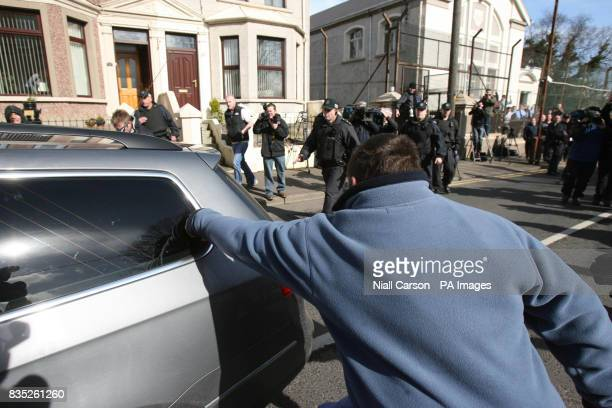 A protester punches the police car carrying the high profile republican Colin Duffy as he is taken away from Larne Court House He has been charged...